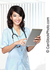 Beautiful doctor using tablet computer