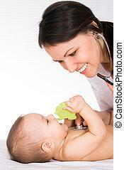beautiful doctor with newborn