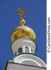 Beautiful domes of Christian Church on blue sky background