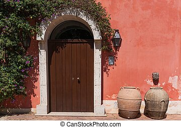 Beautiful door decorated with flowers in italy
