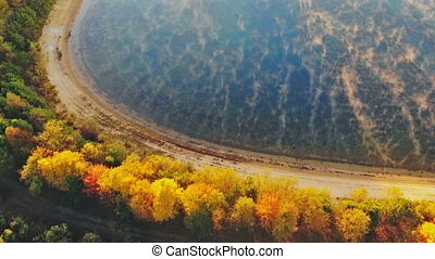 Beautiful dramatic multicolored autumn landscape of lake in the forest