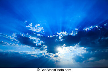 Beautiful dramatic sky with sun rays.