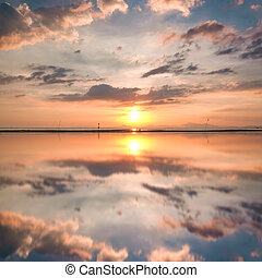 Beautiful dramatic view of nature landscape will full reflection during sunset.