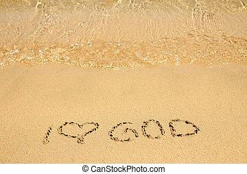 Beautiful drawing on the sand of the sea background