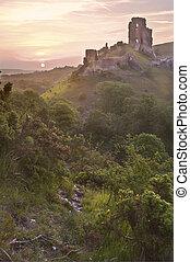 Beautiful dreamy fairytale castle ruins against romantic colorful sunrise