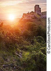 Beautiful dreamy fairytale castle ruins against romantic colorful sunrise