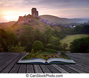 Beautiful dreamy fairytale castle ruins against romantic colorful sunrise coming out of pages in magical book creative concept