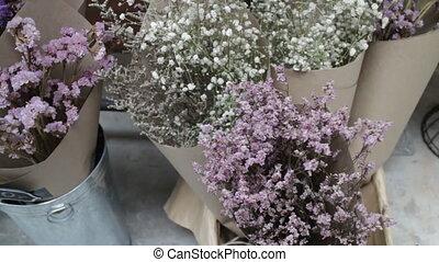 Beautiful dried flower bouquet in bucket, stock footage