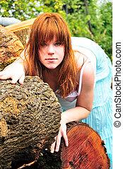 beautiful druid - beautiful redheaded girl having sunbath on...