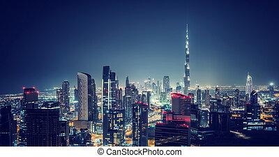 Beautiful Dubai cityscape, bird's eye view on a night urban...