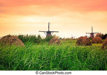 Dutch windmill at sunset from Holland
