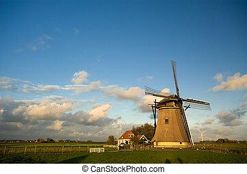 beautiful dutch windmill with blue sky