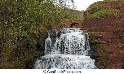Beautiful Dzhurinsky cascading waterfall in autumn. Ukraine