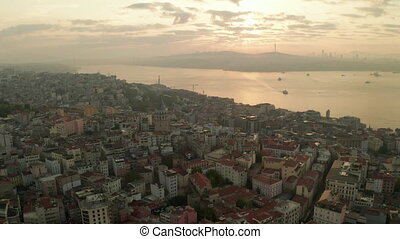 Beautiful Early Morning Above Istanbul Taksim with Galata Tower in Sunrise Light, Aerial Establishing Shot slide left
