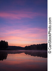 sunrise over the lake in the forest