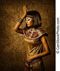 Beautiful egyptian woman bronze portrait over grunge dark...