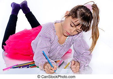 Beautiful eight year old girl drawing with color pencils