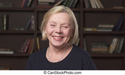 Beautiful elderly blonde woman smiling