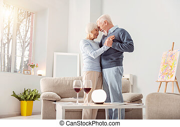 Beautiful elderly couple bonding while dancing