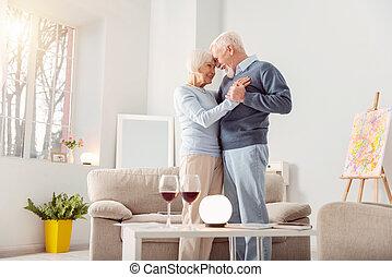 Beautiful elderly couple bonding while dancing