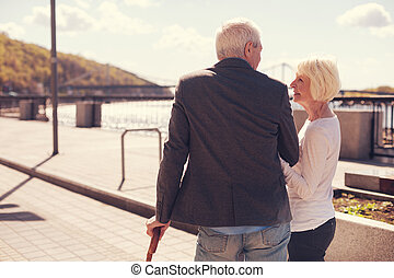 Beautiful elderly couple having a romantic walk
