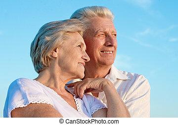 elderly couple on the background of sky