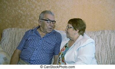 Beautiful elderly couple talking.