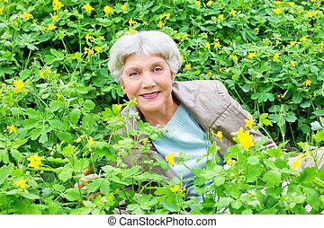 beautiful elderly woman of flowers