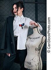 Beautiful elegant brunette woman dressed in fashion mens suit