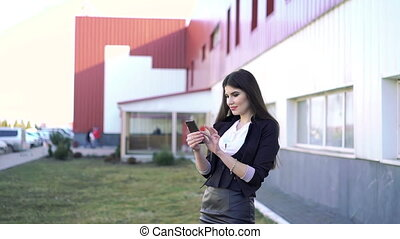 beautiful elegant business woman using smartphone