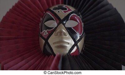 Beautiful elegant venetian mask on the wall