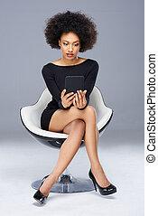 Beautiful elegant woman in a modern armchair