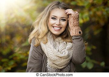 Beautiful elegant woman in park - autumn