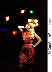 beautiful elegant woman on city lights background