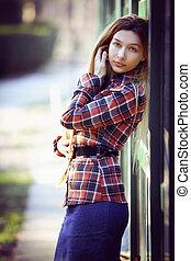 Beautiful elegant woman posing outdoor