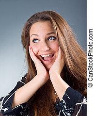 beautiful emotional brunette girl on whitey background