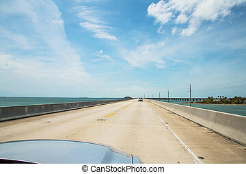 Beautiful endless road from Miami to Key West driving Ford Mustang. Seven mile bridge.
