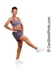 energetic black woman doing aerobics