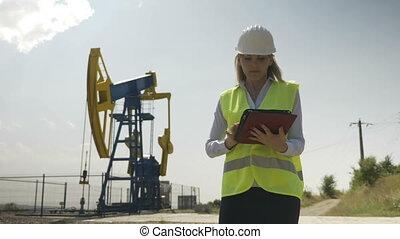 Beautiful engineering woman evaluator working on her digital...