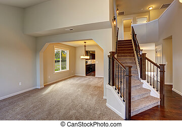 Beautiful entry way with carpet staircase.
