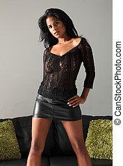 Beautiful ethnic fashion model in black lace top