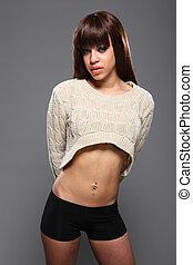Beautiful ethnic model in sexy fashion jumper