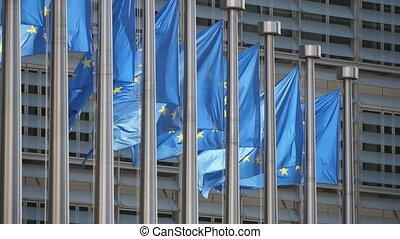 Beautiful EU flags waving at European Commission on a sunny...