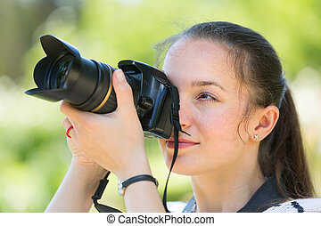 photographer with camera outdoor