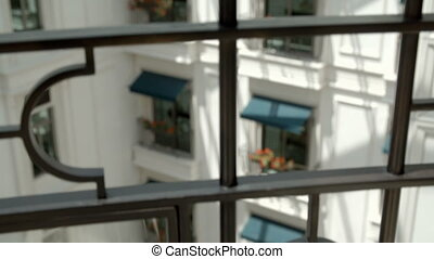Beautiful European flower balcony - A tilting up and focus...