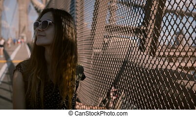 Beautiful European woman in stylish sunglasses walking to...