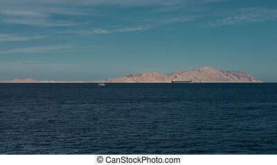 beautiful evening landscape of sea and mountains timelapse. Evening view of the red sea. boat in the sea. ship in the sea time lapse 4K