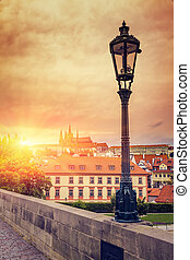 Beautiful evening sunset scenery Of the Old Town and Charles Bridge over Vltava river in Prague, Czech Republic