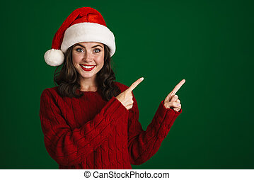 Beautiful excited young woman in red sweater