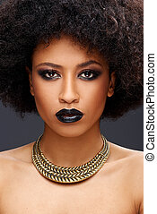 Beautiful exotic African American woman with a curly afro...